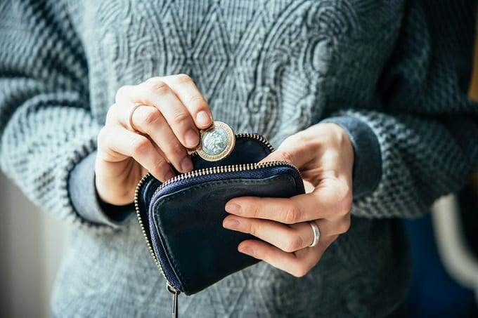 Putting Coin In Wallet